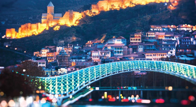 Tbilisi at night with the view of Narikala fortress and Bridge of Peace.